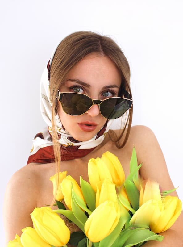 Must de Cratier silk scarf with yellow tulips makeup editorial beauty face