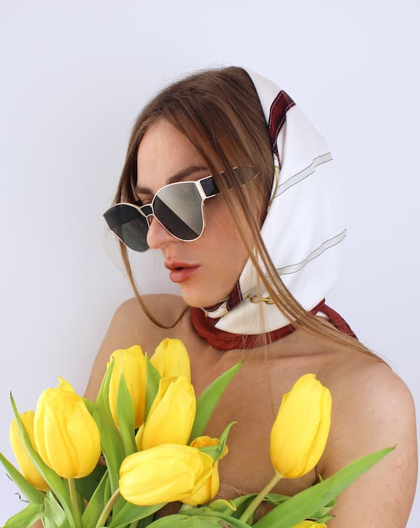 Luxury shopping in Lisbon Must de Cratier silk scarf with yellow tulips makeup editorial beauty face